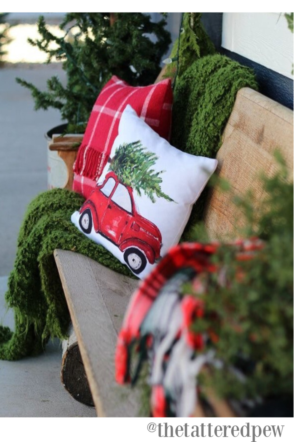 Rustic farmhouse Christmas decor with church pew and pillows - The Tattered Pew. #farmhousechristmas #countrychristmas #holidaydecor