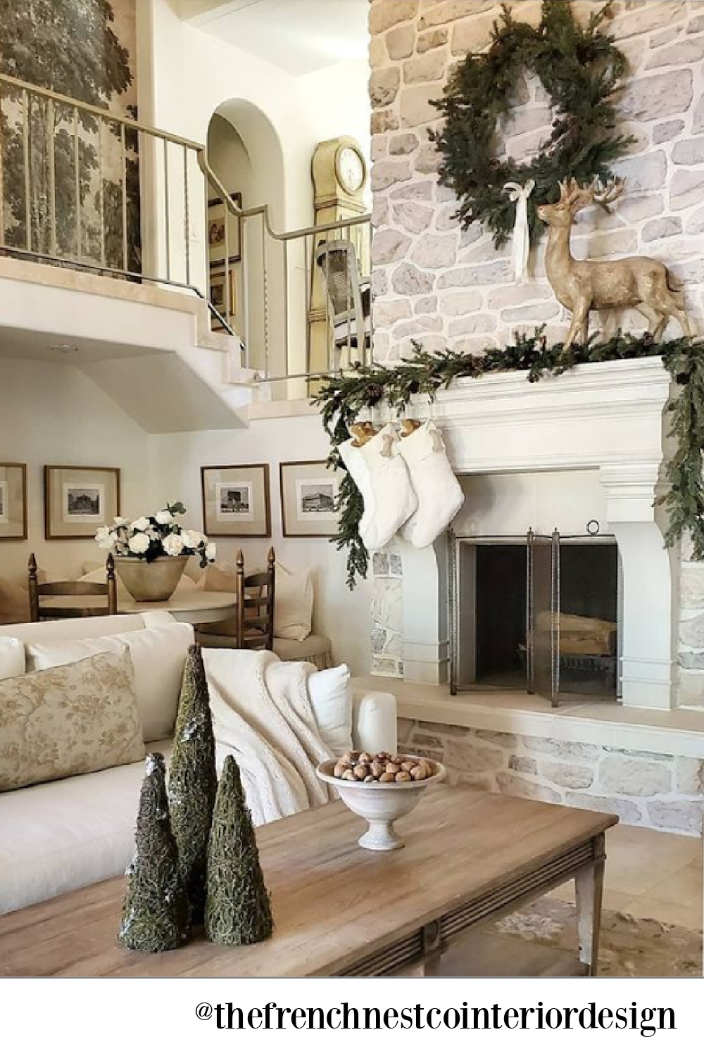 French country Christmas decor in a lovely living room with neutral palette and white - The French Nest Co Interior Design. #whitechristmasdecor #frenchcountrychristmas
