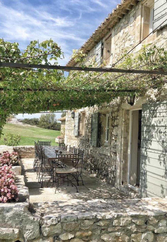 Rustic elegant stone French farmhouse pergola and exterior with shutters - Vivi et Margot. #frenchfarmhouse #houseexteriors #rusticfarmhouse