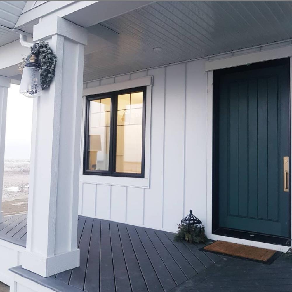Tarrytown Green painted front door (Benjamin Moore) on a white house - Lauren Bennett Interiors. #tarrytowngreen #greendoor #frontdoorcolors
