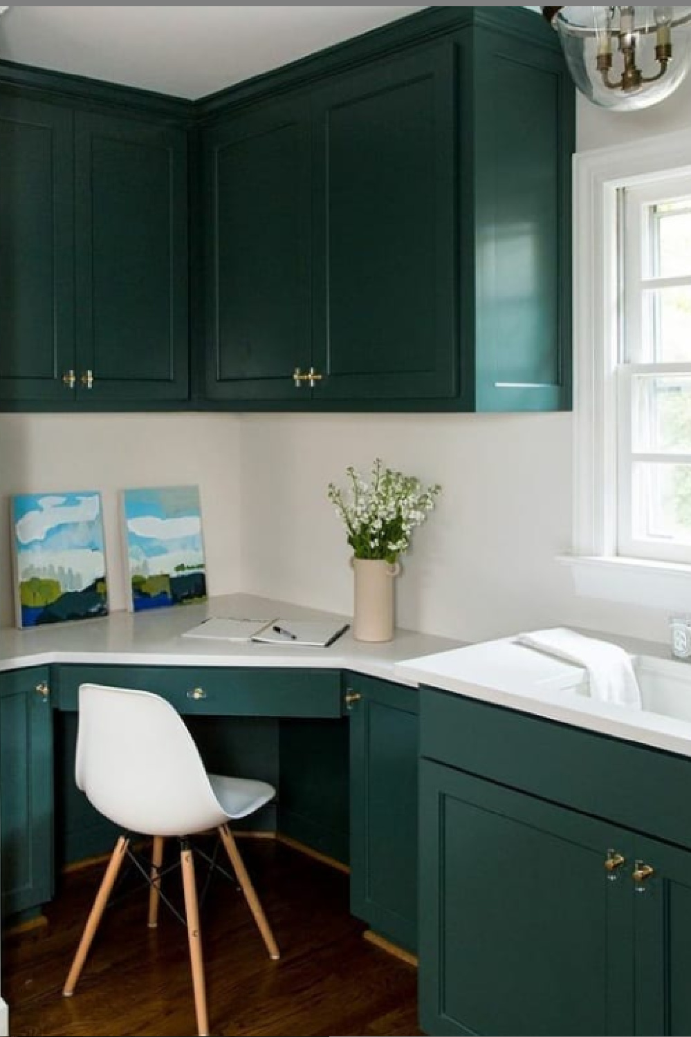Green kitchen cabinets painted BM Tarrytown Green with white walls and MCM desk chair. #tarrytowngreen #paintcolors #greenkitchen