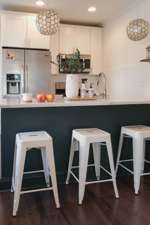 Tarrytown Green (Benjamin Moore) paint color on a breakfast bar in a kitchen - @casio_barnes. #benjaminmooretarrytowngreen #greenpaintcolors