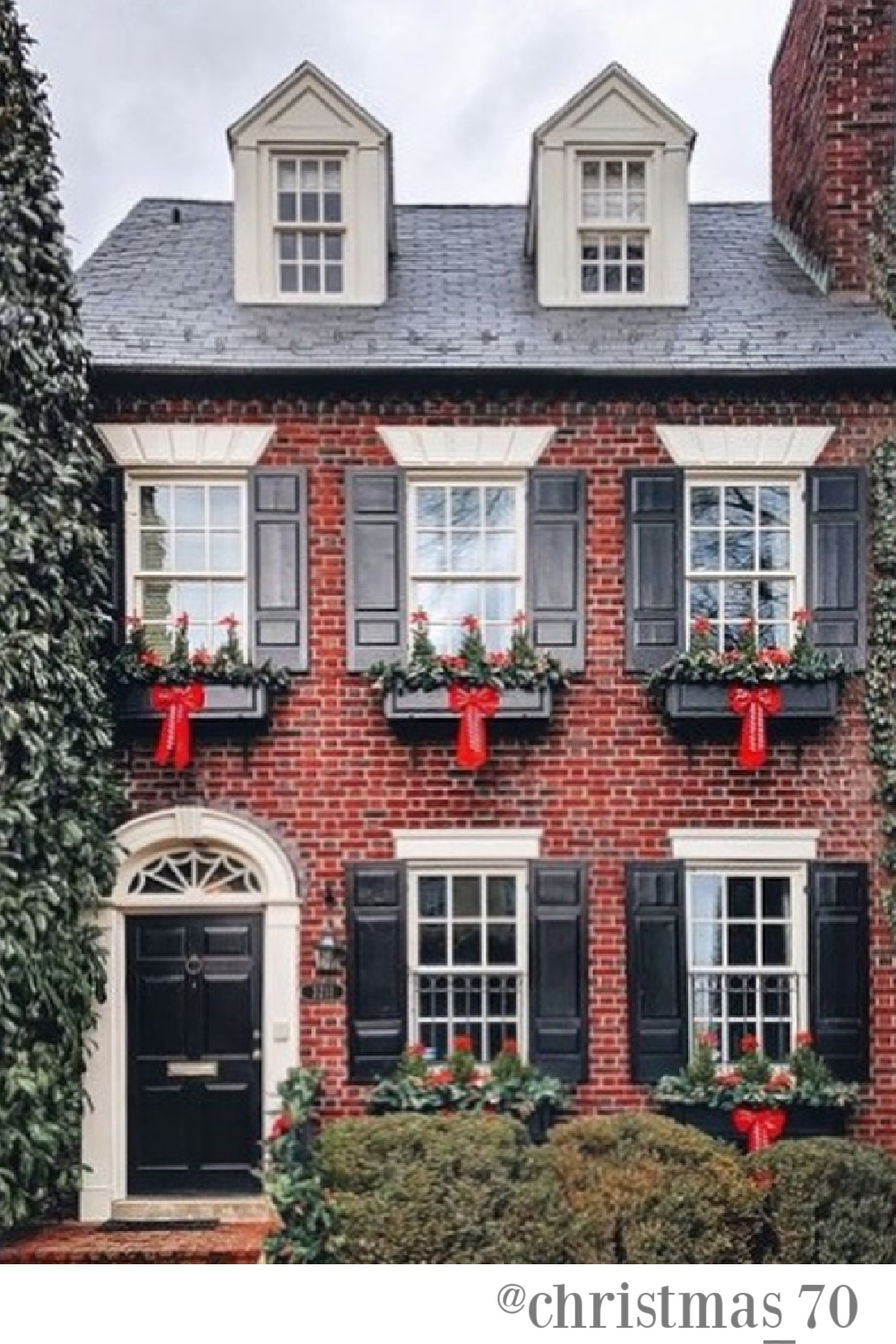 Traditional red brick house exterior decorated with window boxes for holidays - @christmas_70. #christmasdecor #houseexteriors #outdoorchristmasdecor