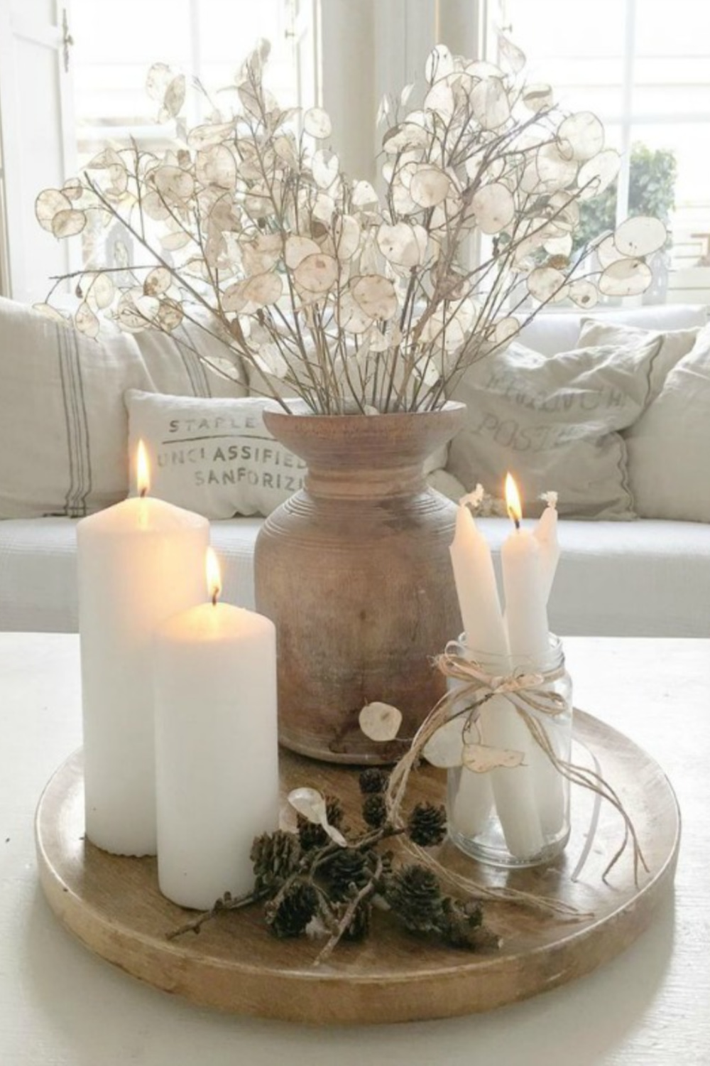 French Nordic living room vignette with candles, pale colors, grain sack pillows, linen and serene style by Villa Jenal. #frenchnordic #livingroom #scandistyle