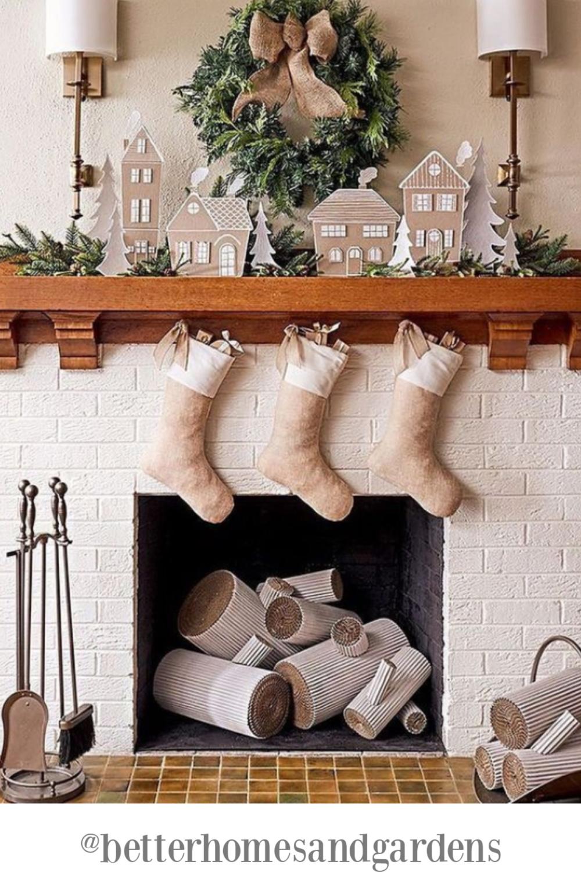 White Christmas decorated white brick fireplace - BHG. #christmasfireplace #christmasstockings #holidaydecor