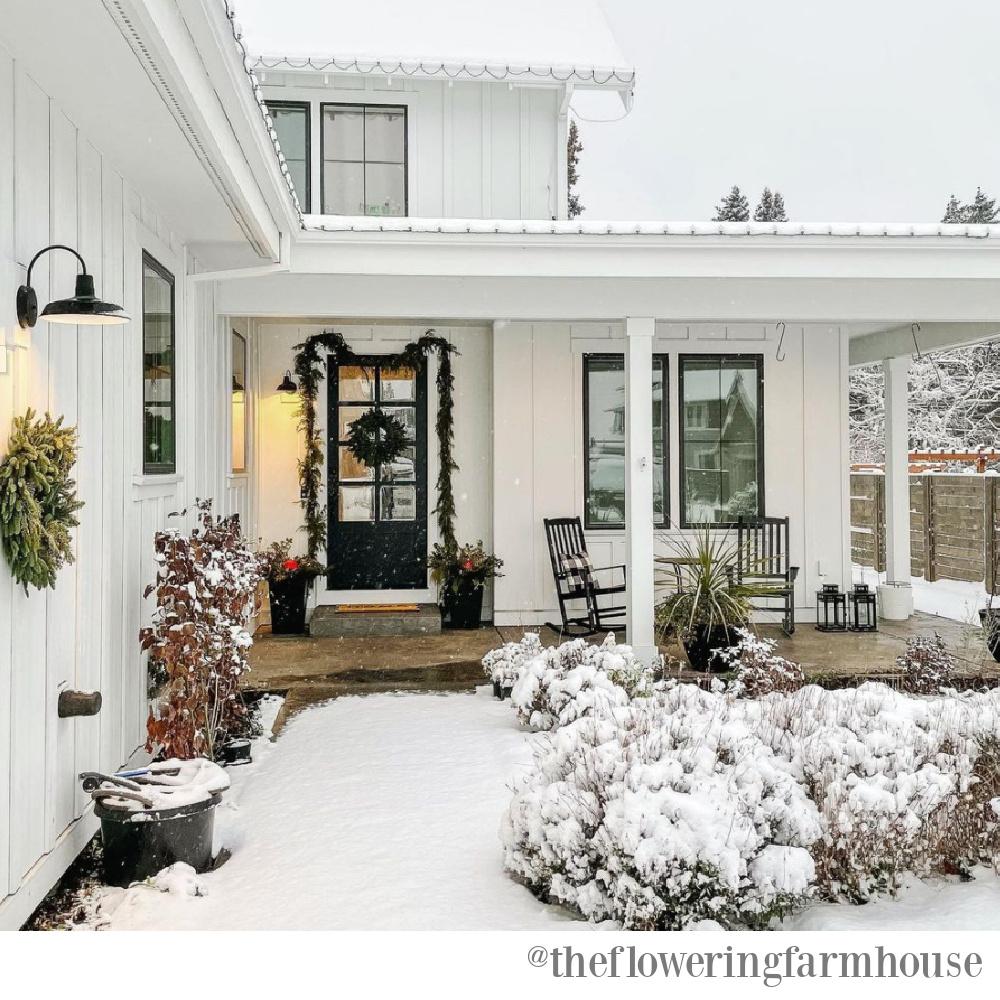 Farmhouse Christmas decor and a beautiful winter porch - The Flowering Farmhouse. #farmhousechristmas #christmasdecor