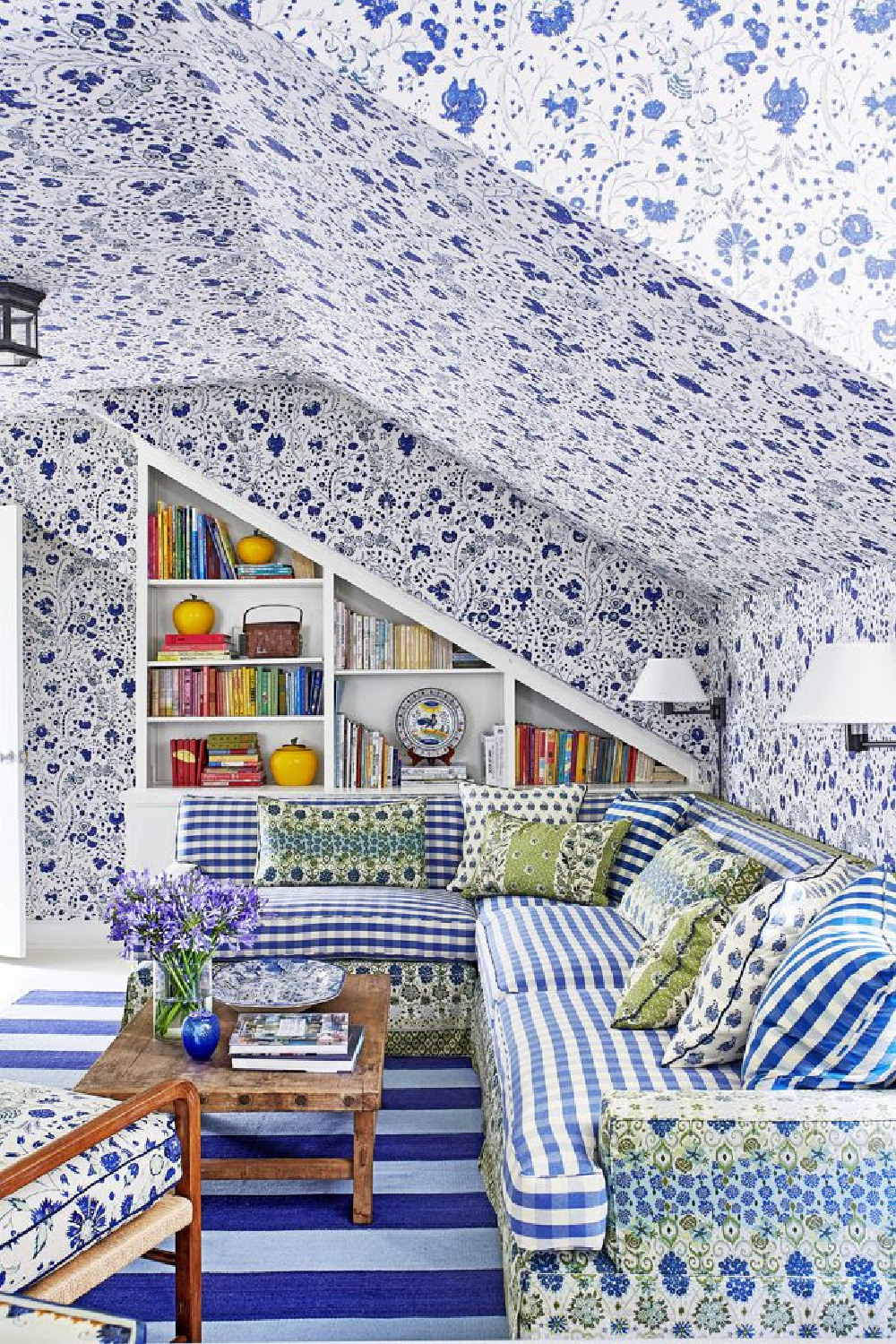 Beautiful mixed royal blue patterns of wallpaper and upholstery in a charming traditional space - design by Mark Sikes.