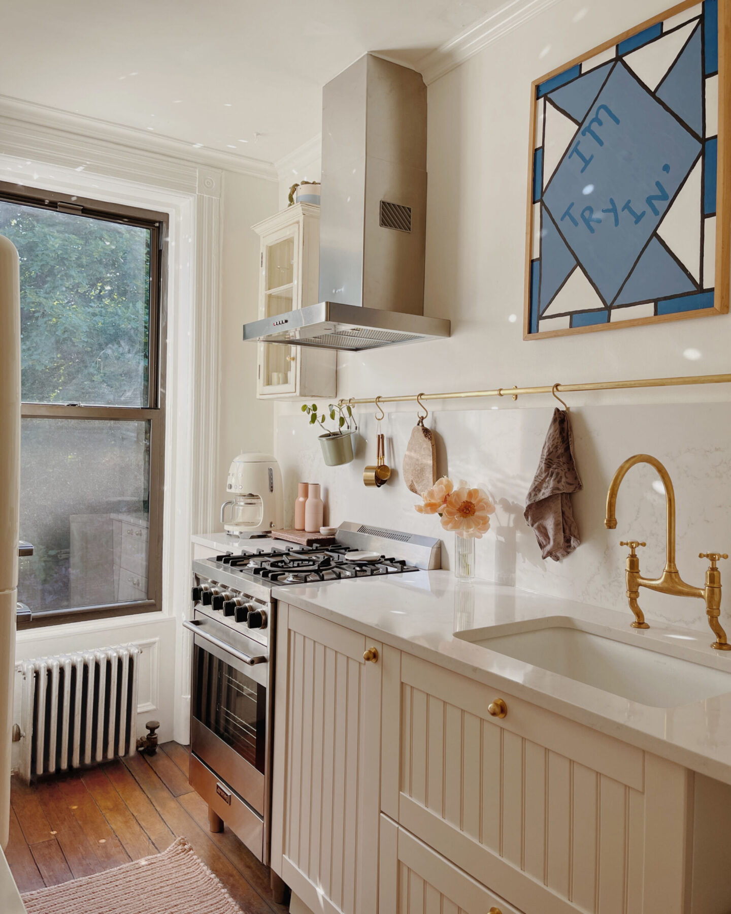 Gorgeous Nieu Cabinet Doors in ReserveHome's Brooklyn Brownstone remodeled kitchen. #customkitchen #cabinetrefacing #kitchenremodel #beforeandafter