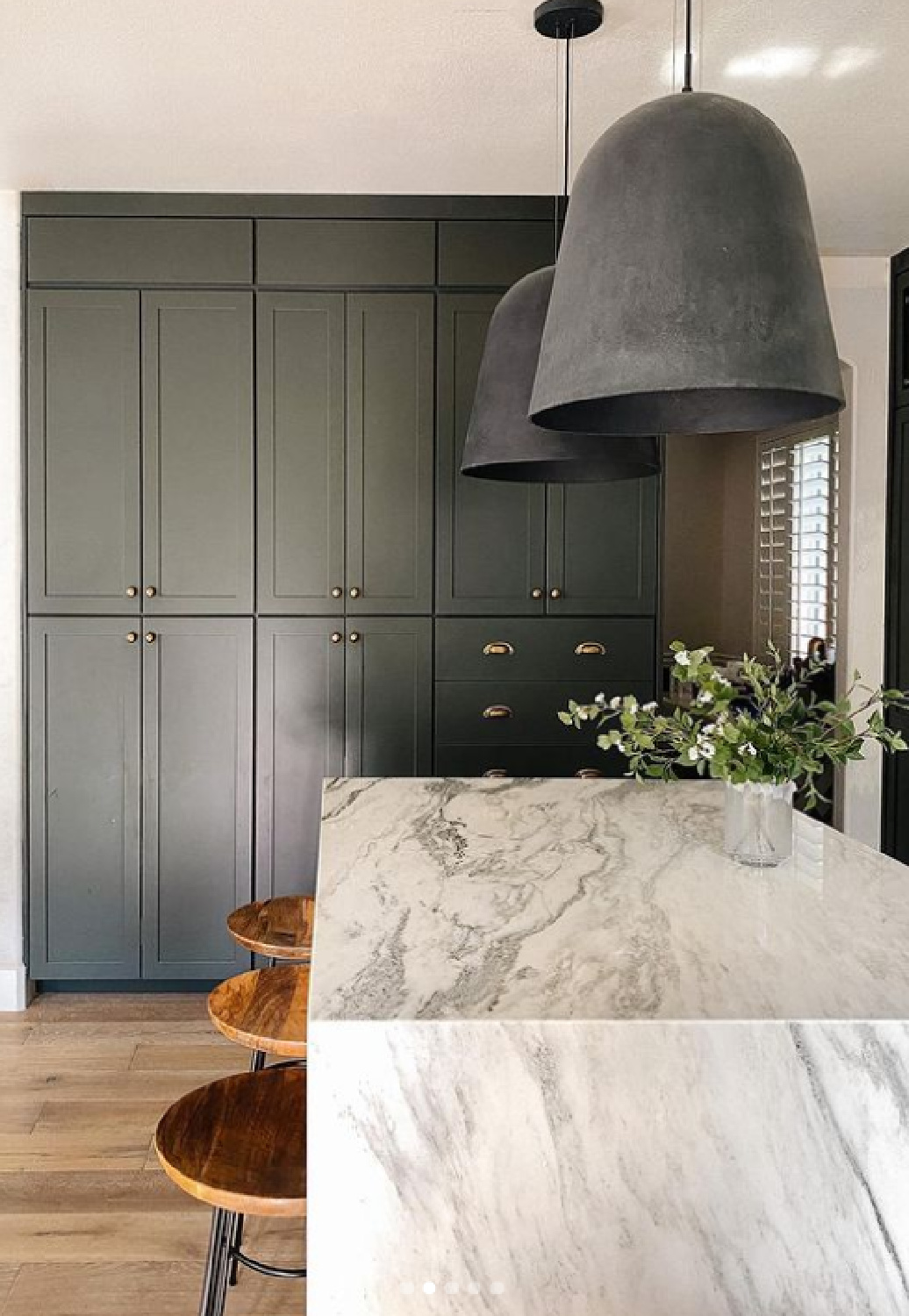 Customized cabinet fronts from NIEU (Angela Rose Slim Shaker Detail in Dream Dusk) in a luxurious kitchen with marble island and moody dark color. #refacedcabinets #customcabinetfronts #nieu