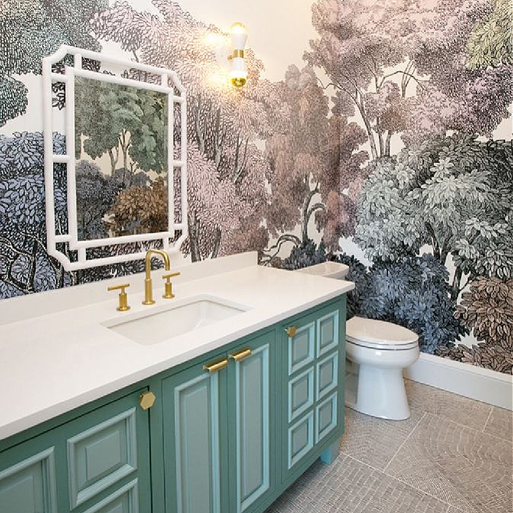 Caesarstone Pure White quartz countertop in a beautiful bath with green vanity and a landscape wallpaper mural - design by Whittney Parkinson. #caesarstonepurewhite #whitequartz