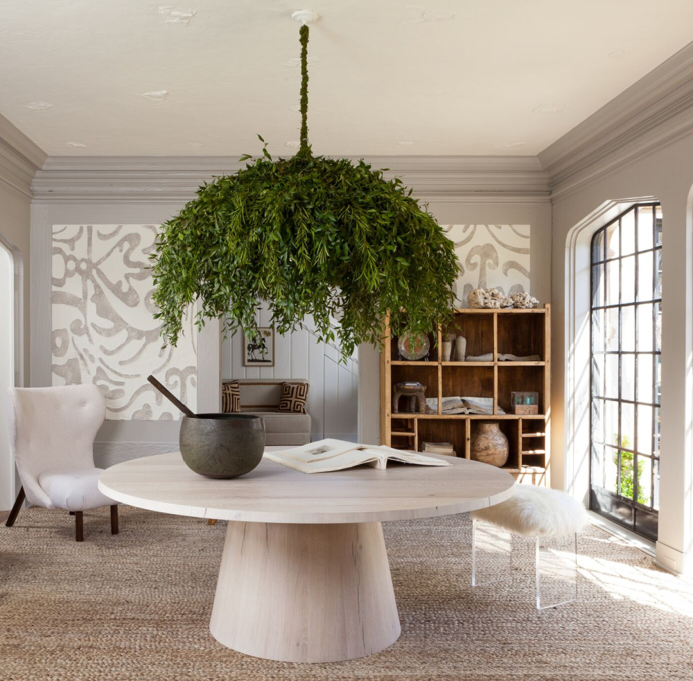 Botanical chandelier over a modern round dining table in a designer showhouse - Michael Del Piero.
