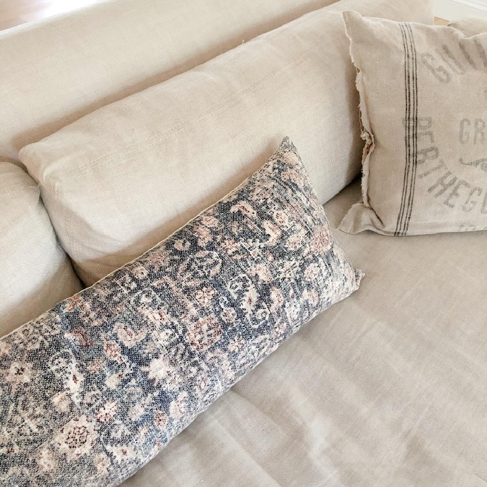 Montara pillow (Amber Lewis x Loloi) on my Belgian linen slope arm sofa by RH - Hello Lovely Studio.