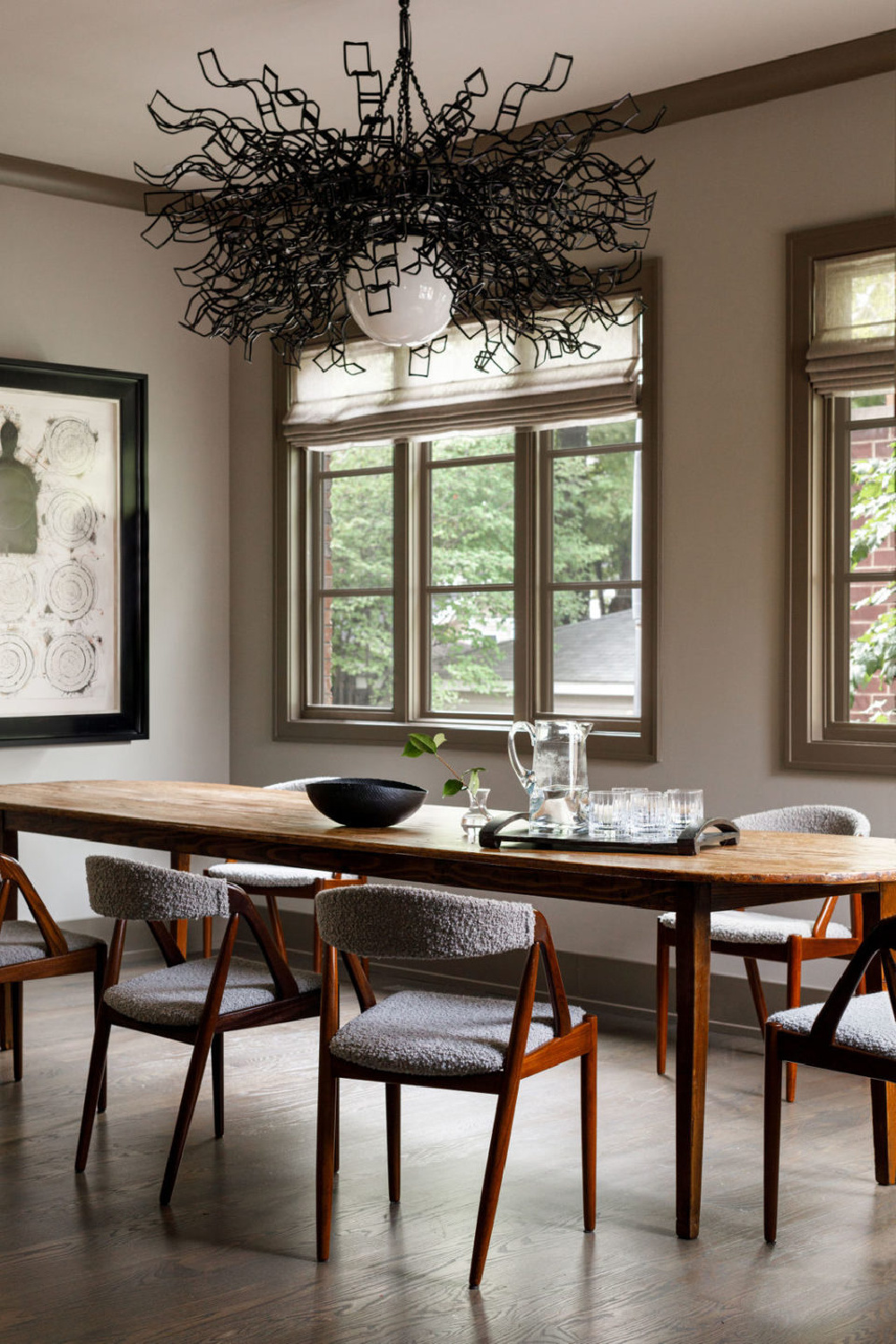 Modern rustic dining room with sculptural chandelier by Lucy Slavinski and interior design by Michael Del Piero.