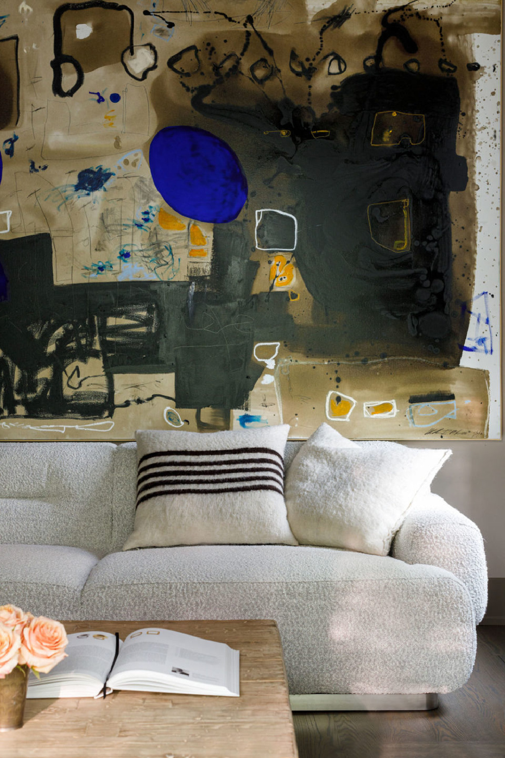 Bold saturated neutrals in a modern abstract painting in a living room designed by Michael Del Piero in Chicago.