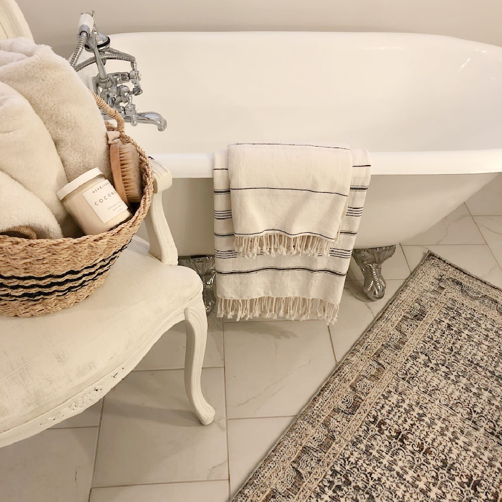 Amber Lewis x Loloi ocean multi area rug in my vintage style bath with clawfoot maid's tub - Hello Lovely Studio.