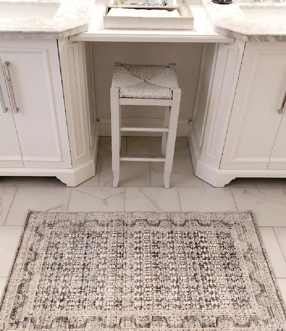 Amber Lewis x Loloi Zuma Zum ocean area rug in my bathroom with calacatta look porcelain tile - Hello Lovely Studio.