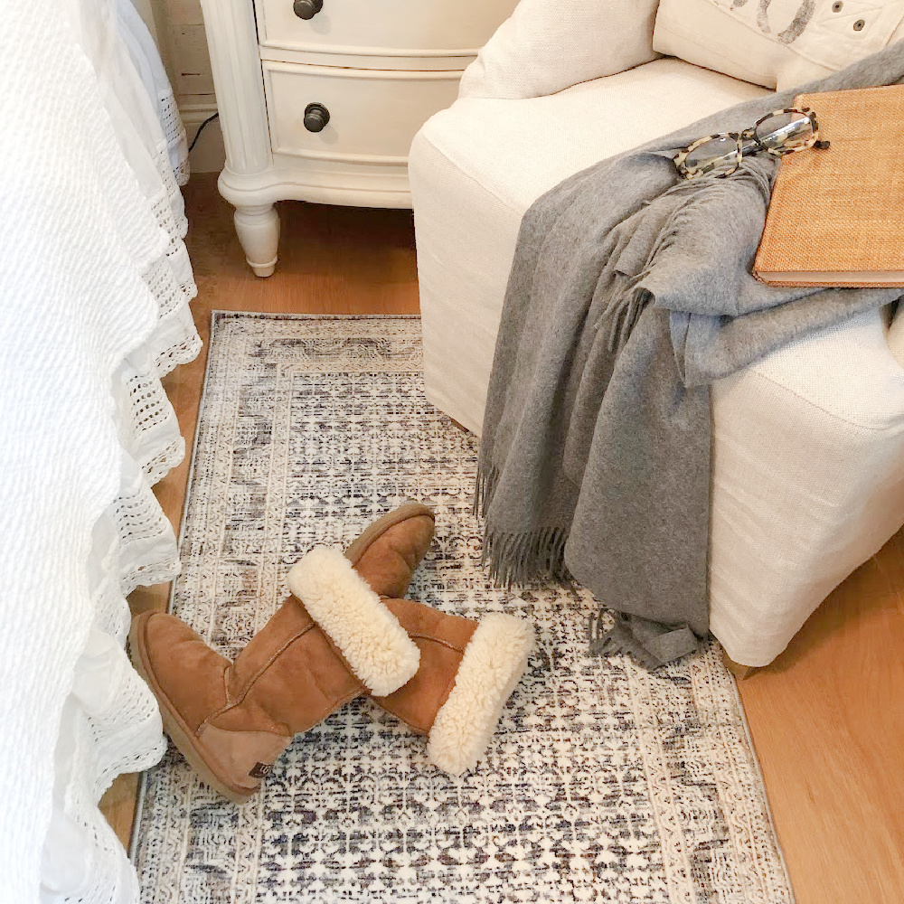 Ugg tall boots in Hello Lovely's fall bedroom with Zuma Zum ocean area rug (Amber Lewis x Loloi).