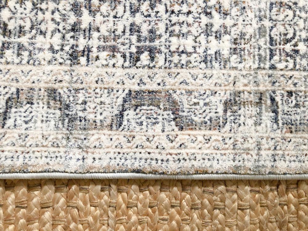 Amber Lewis x Loloi Zuma Zum Ocean Area Rug layered over a jute rug - Hello Lovely Studio.